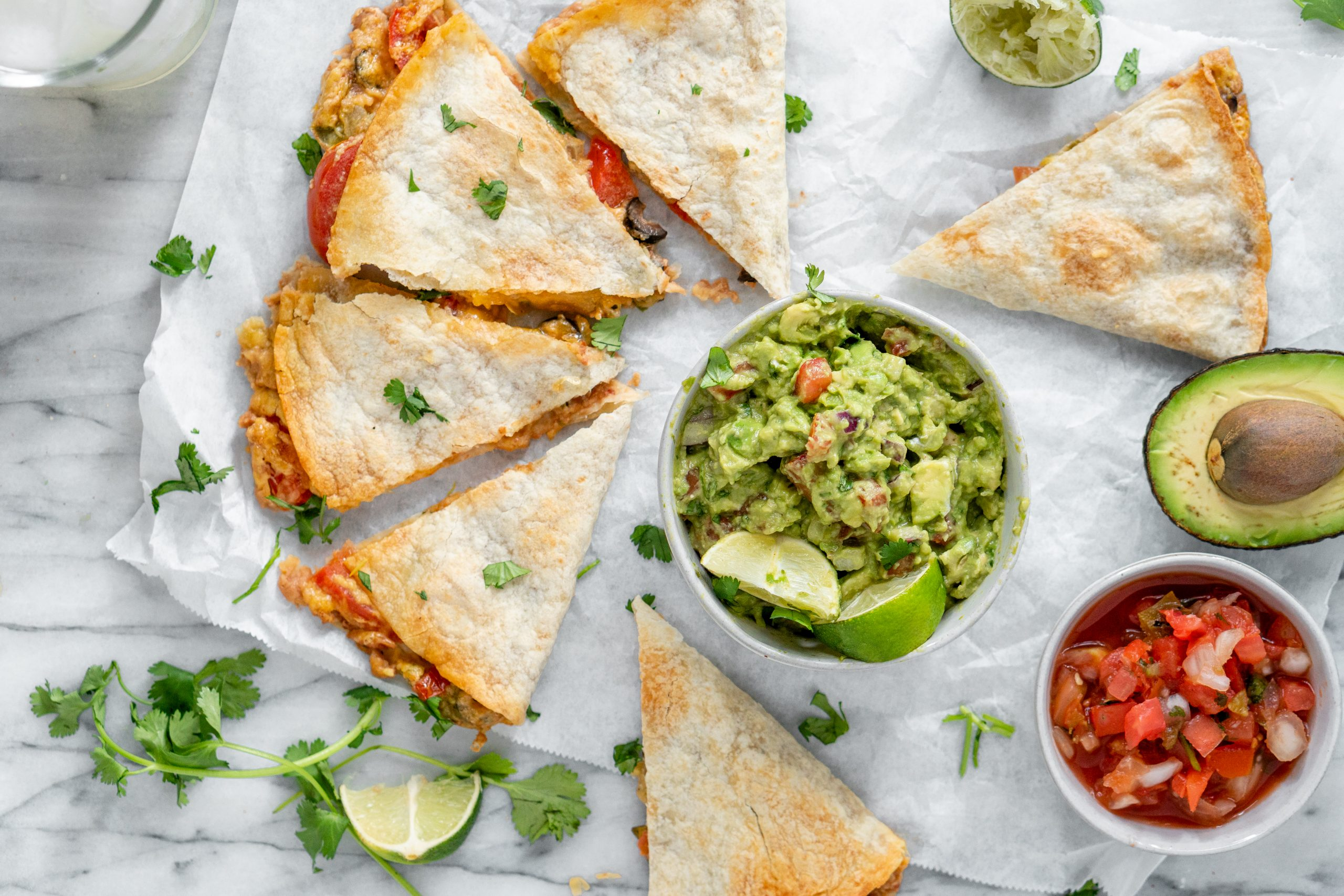 7 Layer Quesadilla pictured with guacamole and salsa