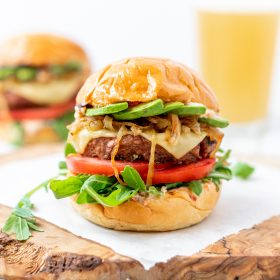 Beyond Burger with avocado, caramelized onions, tomato, arugula, and sun dried tomato aioli