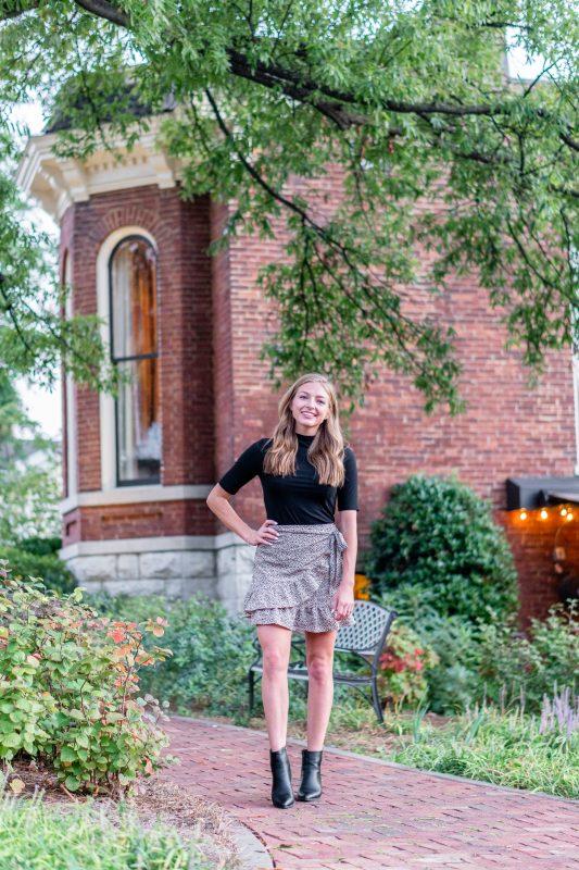 Blonde girl standing in front of Husk Restaurant in Nashville