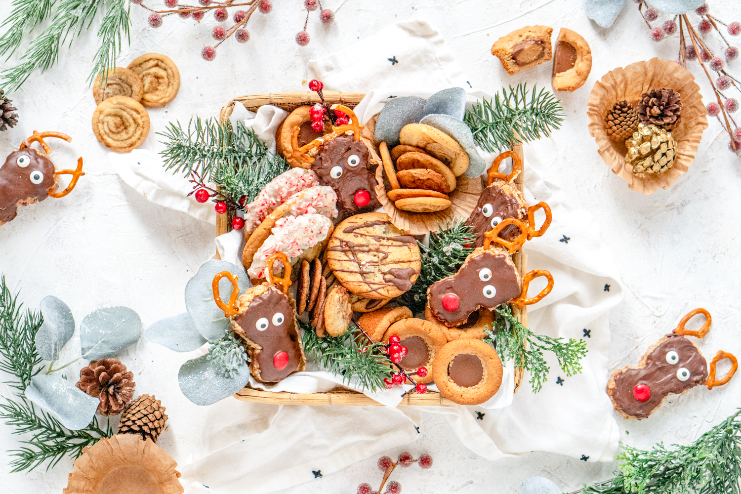 Cookie Box filled with a variety of cookies surrounded by christmas garland