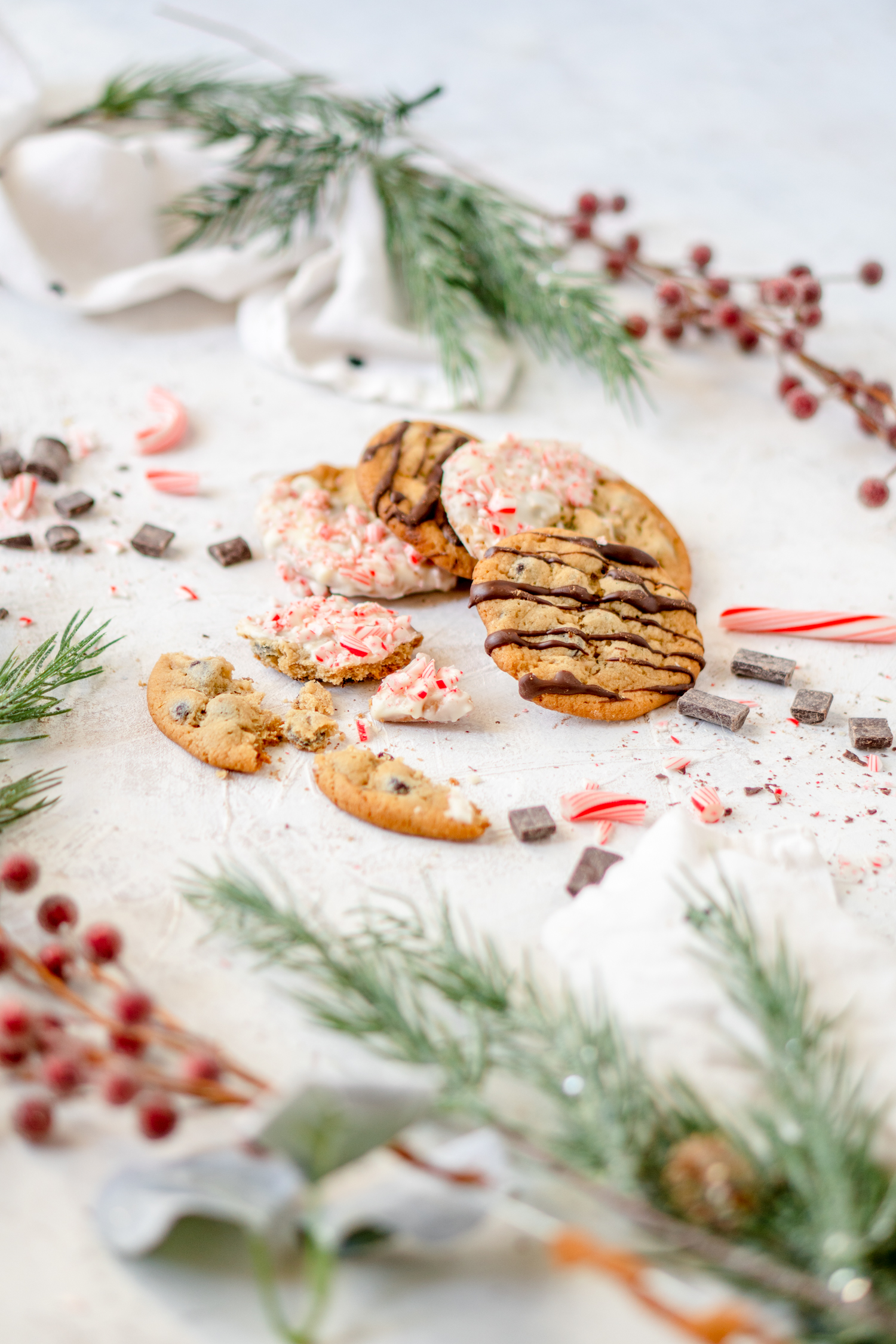 Chocolate chip cookies drizzled and dipped in chocolate with Christmas decorations