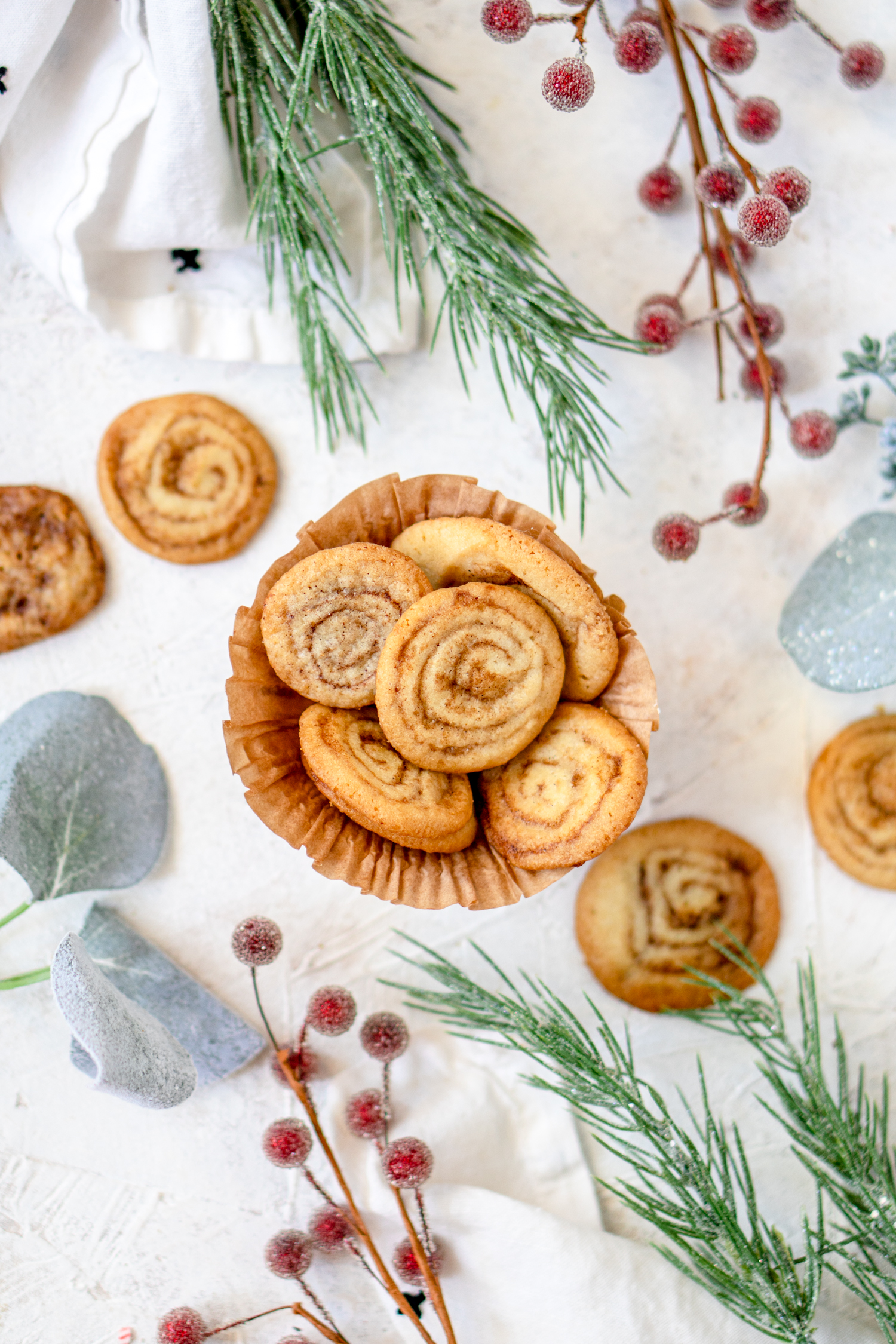 Cinnamon roll cookies surrounded with christmas decor