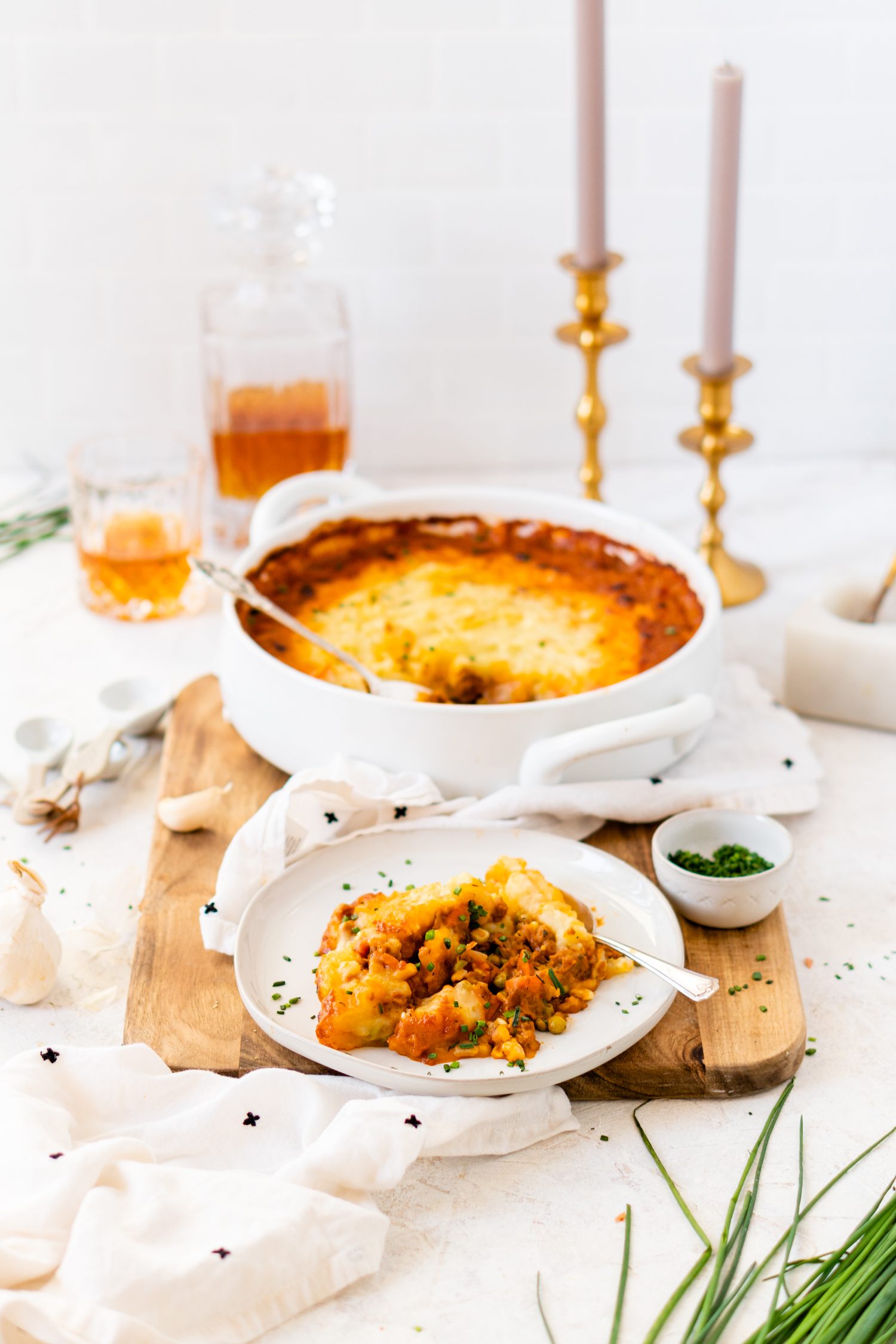 Vegan Shepherd's Pie on a plate and in a serving dish