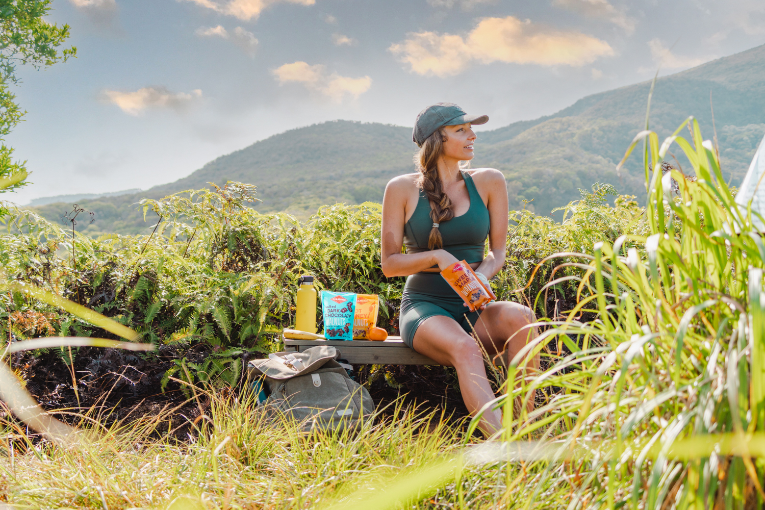 Girl sitting on bench at the final viewpoint of the Mahana Ridge Trail